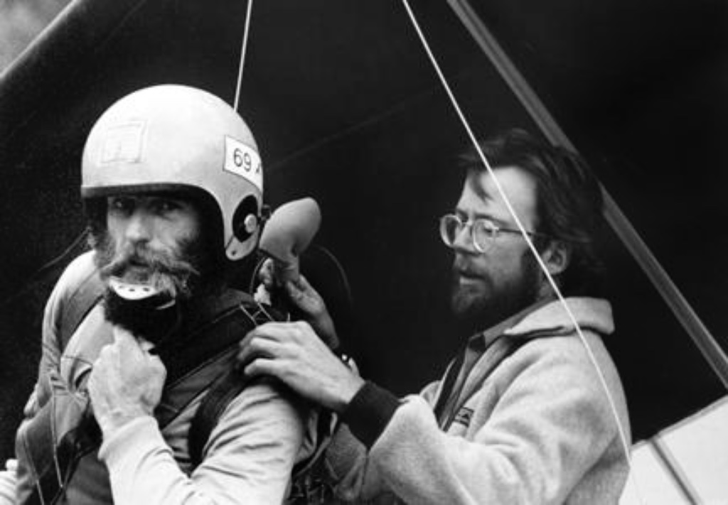Norman Squier outfits Captain' Jack Carey for a historic KOTO high-altitude remote broadcast in 1982. Carey would circle the valley via hang glider and report live. The longtime local and cerebral daredevil. [Photo by Ingrid Lundahl]